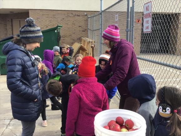 Students from Mrs. Givens� 2nd grade class are learning how to use a hand-cranked apple cider press.