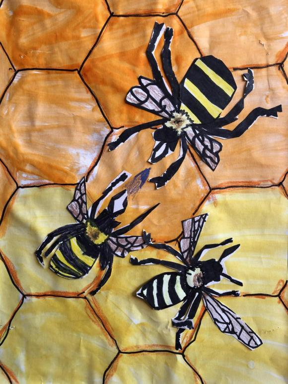 Students created their own honey bee drawings to add to a large honeycomb that covered a wall in the art room.